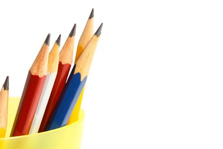 pencils in yellow cup on white background  Stock Photo