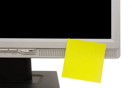 yellow sticker onmonitor. close-up.white background.
