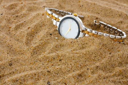 hand watch in sand