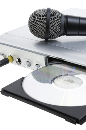 CD player and microphone on white background