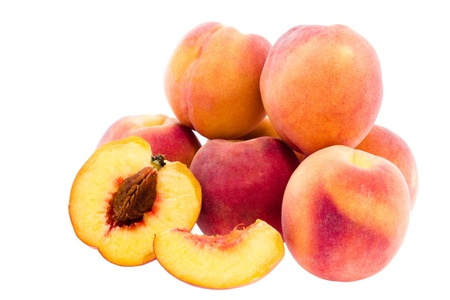 half, share and a few peaches on  white background Stock Photo