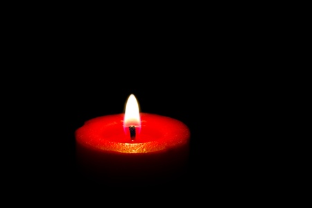 red wax candle on black background  Stock Photo