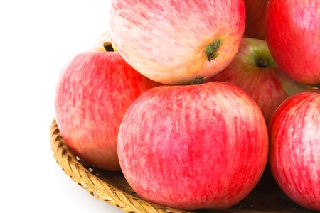 apples in basket on white background