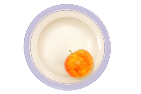 apple in plate on white background