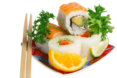 sushi rolls and wooden sticks on plate. white background.