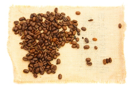 heap coffee beans on burlap. white background