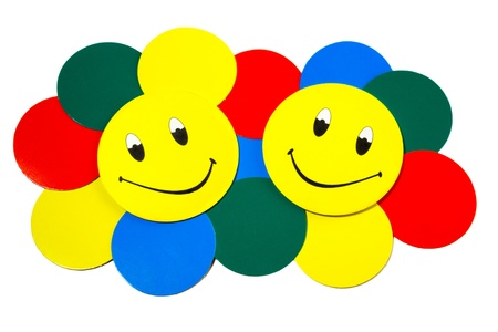 two smiles and colored circles on a white background