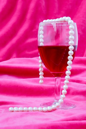 red wine and pearl on pink  background