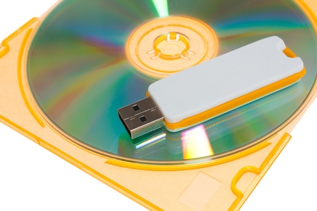 CD and USB flash drive on white background