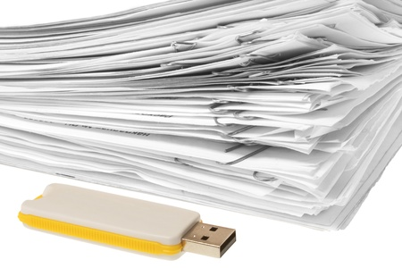 USB flash drive and stack of paper. white background Stock Photo