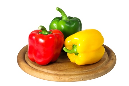 peppers on a cutting board. white background