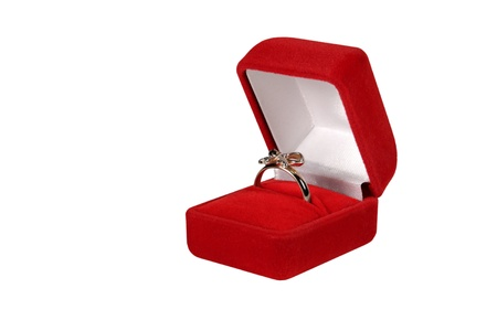 gold  ring in red box on white background Stock Photo