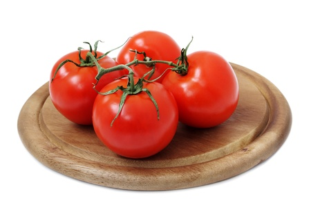 four tomato on cutting board  white background