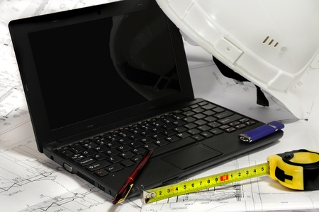 open laptop and Helmet,measure tape on draft Stock Photo