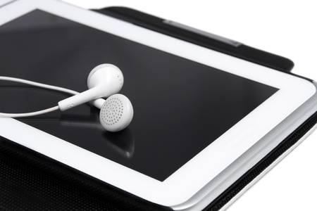 Headphones on digital tablet   close up  White Background