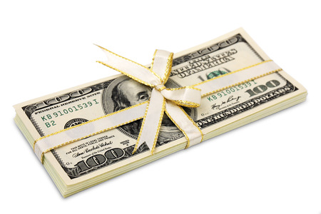 Stack of hundred-dollar bills tied with a white ribbon on white background Stock Photo
