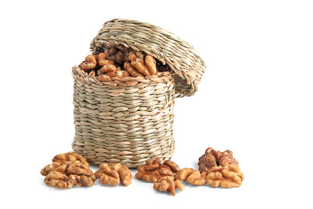 basket with walnuts on white background