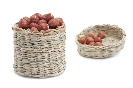 hazelnut in basket on white background Stock Photo