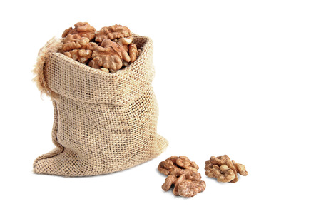sack with walnut on white background