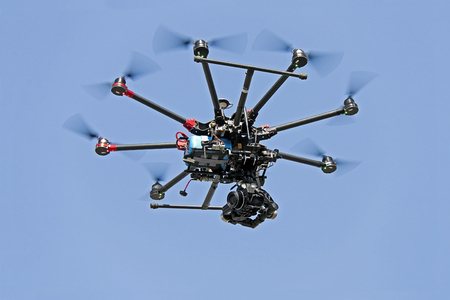 drone in blue sky Stock Photo