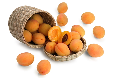 basket with apricot on white background Stock Photo