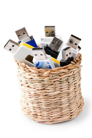 usb storage in basket on white background