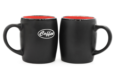 Two black mugs on a white background