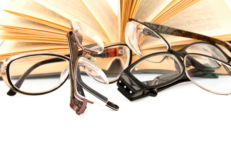 eyeglasses  choice and open  book on white background Stock Photo
