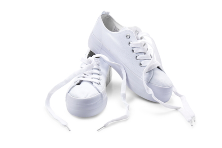 white sport shoes on white background
