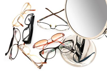 eyewear and mirror on white background