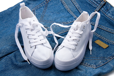 sports shoes on jeans