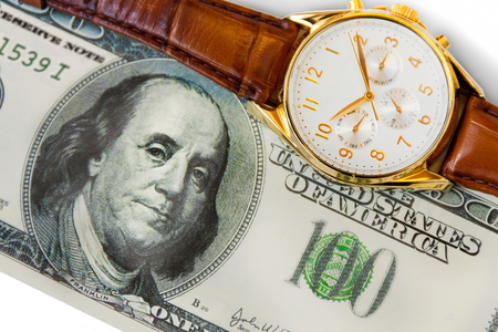 watch and hundred dollars on white background Stock Photo