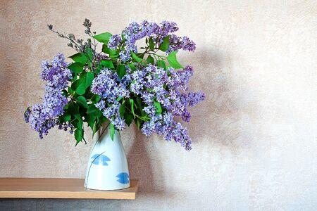 lilac flower on  shelf Stock Photo