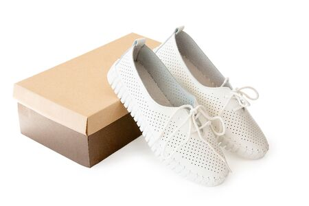 new white shoes and cardboard box on white background Stock Photo
