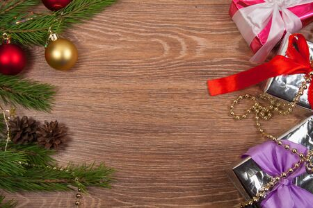 Background.branchs  fir and presents with christmas ornament.Wooden message  space Stock Photo