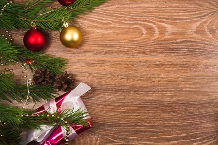 Background.branchs  fir and present with christmas ornament.Wooden message  space Stock Photo