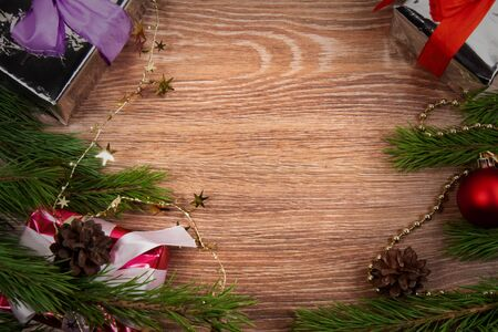 Background. branchs  fir and presents with christmas ornament.Wooden message space