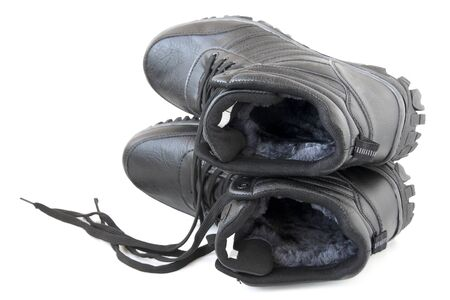 males  winter shoes on white background Stock Photo
