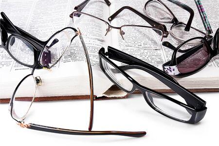 heap eyeglasses  on  book. white background