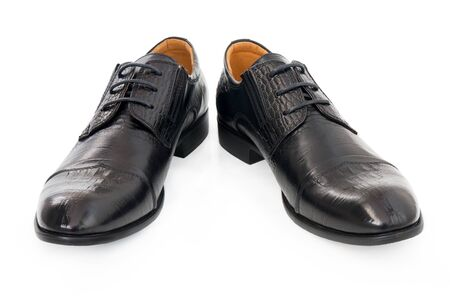 Men's shoes made of crocodile skin on white background