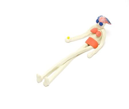 Female plasticine figure on white photo