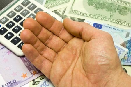 Dollar, euro banknotes, calculator and human hand photo