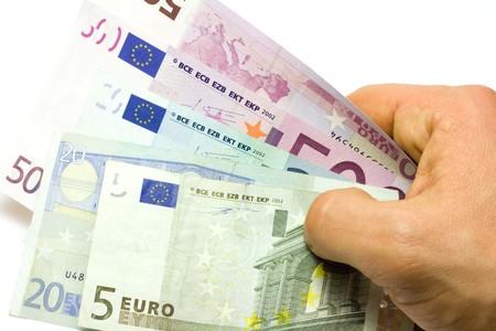 fondos violeta: Los billetes en euros Humanos de la mano de