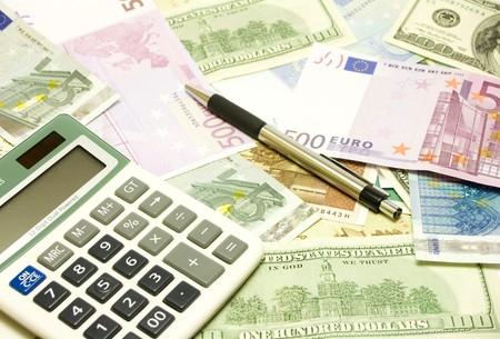 Dollar, euro, lat banknotes, calculator and pen photo