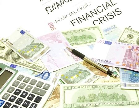 Dollar, euro, lat banknotes, calculator, pen and financial crisis photo