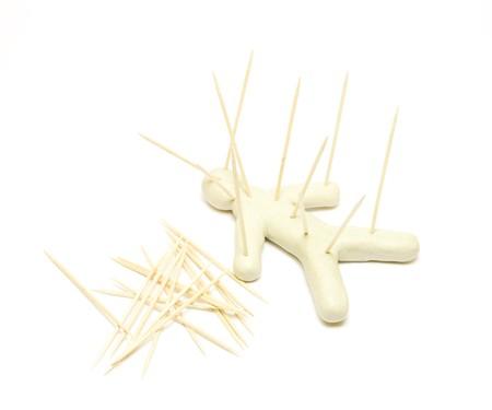 Plasticine figure voodoo on white photo