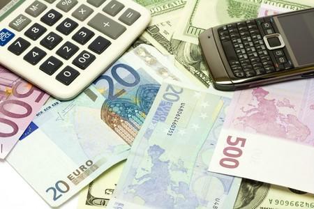 Dollar, euro banknotes, calculator, cellphone photo