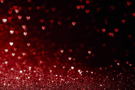 valentines day background with red hearts glitter bokeh on black, card for Valentine's day, christmas and wedding celebration, Love bokeh shiny confetti textured template