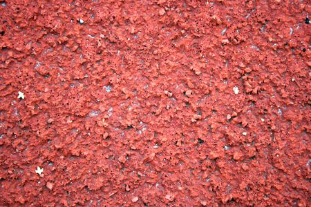 regular: Background of a red tile athletic track.
