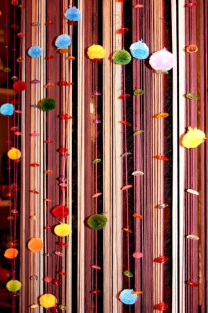 Vertical curtains decorated coloured balls Stock Photo - 4350466